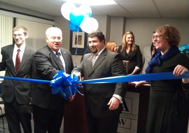 Mayor James McDonald (left) welcomes Engle & Associates, P.C.