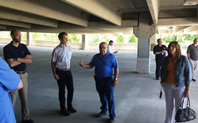 In Downtown Auburn Hills, builder Dennis Burt talked to the class about the complexities of building the new Graduate Housing Apartment Complex and Parking Structure.
