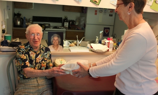 Auburn Hills resident receiving a meal from a volunteer