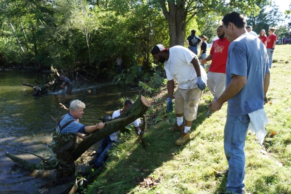 Volunteers clearing a log jam in the Clinton River