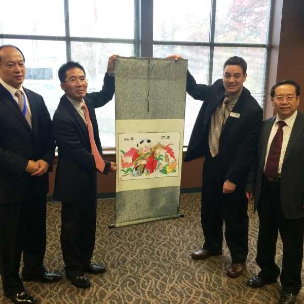 Mayor McDaniel accepts a beautiful gift from the leaders of the Chinese delegation.