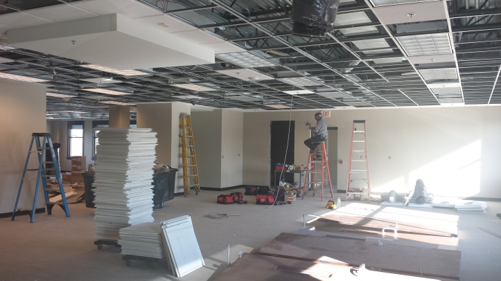 From tile flooring to ceiling panels, the light-filled space is taking shape