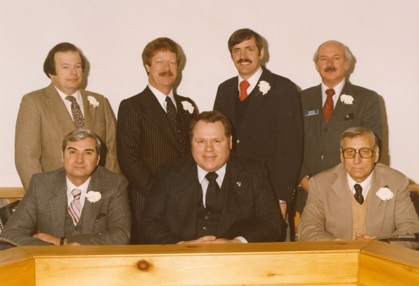 Members of the first Auburn Hills City Council. Top Row (left to right): David Jerrell, Larry Douglas, Michael Davis, and Ronald Shirley. Bottom Row (left to right): E. Dale Fisk, Mayor Robert Grusnick, and Mayor Pro-Tem Walter Smith (Special thanks to Tyson Brown, President of the Auburn Hills Historical Society for this photo)