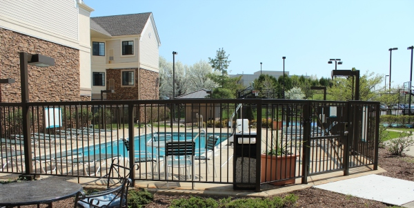 This extended stay hotel literally has everything you need, including a beautiful outdoor area with a pool