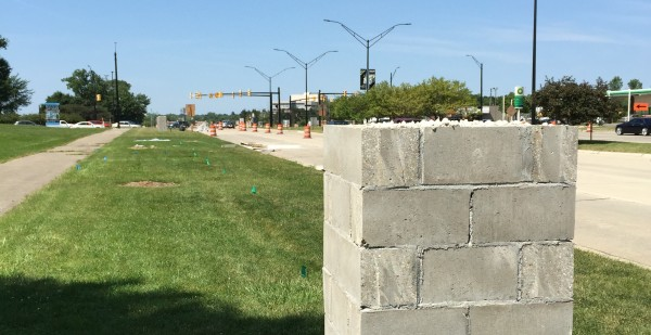 These nondescript block structures will soon become attractive decorative stone pillars