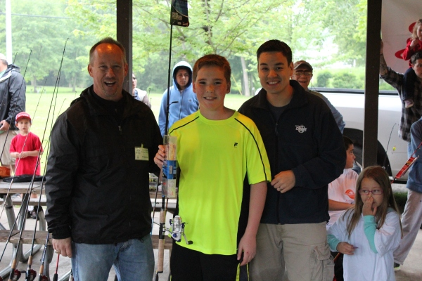 Mayor, Kevin McDaniel and  Parks & Rec Director, Brian Marzolf with one of the lucky raffle winners.