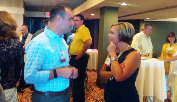 Stephanie Carroll networking with Alan Weber from Oakland County
