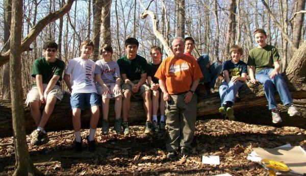 Mike Mansour, pictured here with scouts, leads groups through the process of earning merit badges