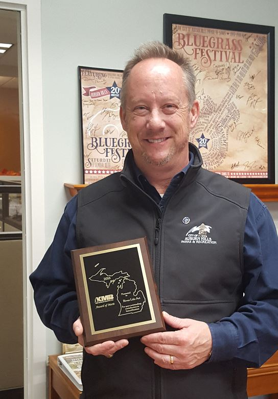 Auburn Hills Parks & Recreation Director Brian Marzolf with 2016 Keep Michigan Beautiful, Inc. Award
